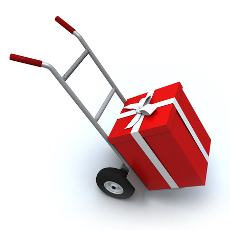 Big red gift box in a push cart photo
