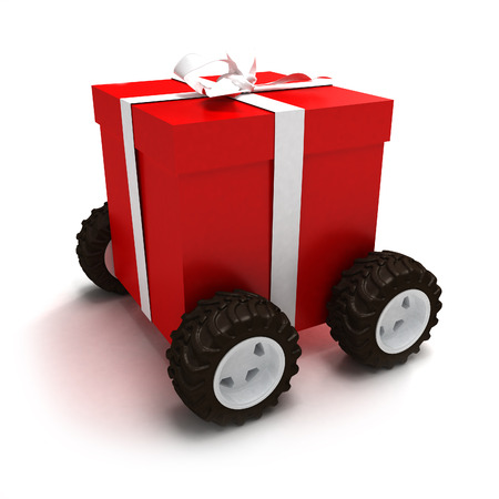 Red gift box with white ribbon on wheels Stock Photo