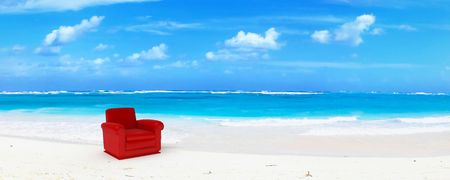A red club sofa in an idyillic beach of white sand and blue water Stock Photo - 2114206
