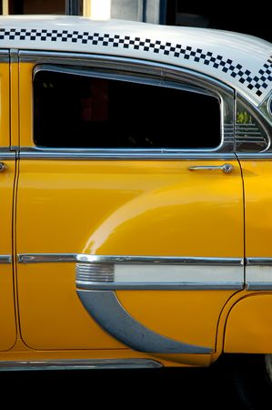a yellow taxi: Detail of a vintage yellow New York cab