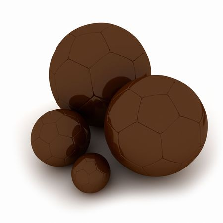 3D rendering of different sizes of football balls made of chocolate photo