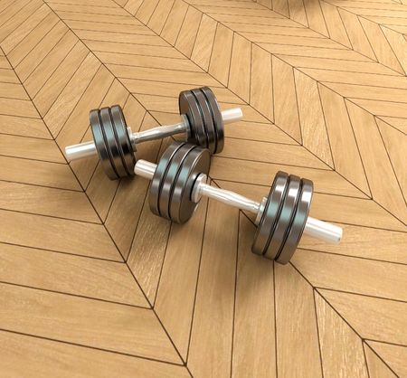 3D-rendering of a pair of dumbbells on a parquet floor Stock Photo - 2731515
