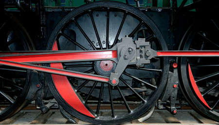 Detail of the wheels of  a steam locomotive. photo