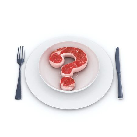eating questions: Raw meat with a question mark shape on a white dish Stock Photo