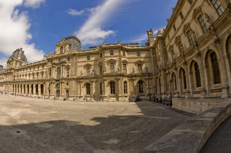ade: Panoramic view of the Louvre fa�ade in Paris Stock Photo