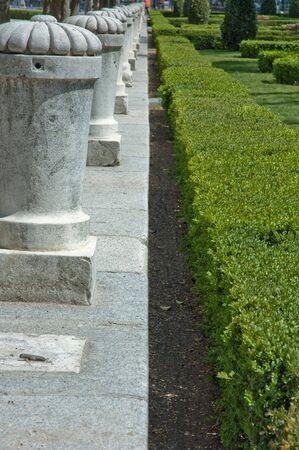 balustrade: Granite balustrade and a hedge Stock Photo