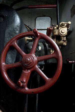 Steering wheel of an old steam locomotive photo
