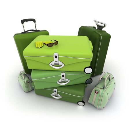 Luggage kit in green shades with traveller�s sunglasses and gloves on top photo