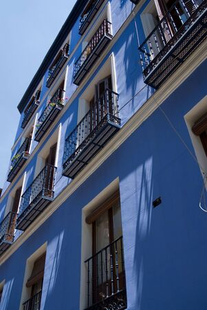ade: A typical fa�ade with balconies in Madrid painted in blue Stock Photo