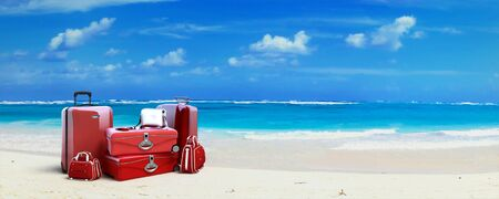 vanity bag: Pile of  red baggage on a tropical beach Stock Photo