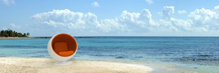 A spherical designer seat in the middle of a tropical beach Stock Photo - 3342336