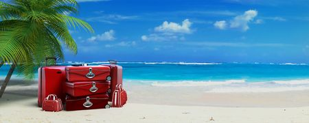 luggage travel: Pile of  red baggage on a tropical beach Stock Photo