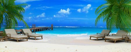 3D rendering of two pairs of lounge chairs by a jetty on a tropical idyllic beach photo