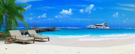 pier: 3D rendering of a pair of lounge chairs by a jetty on a tropical idyllic beach with a luxurious yacht passing by