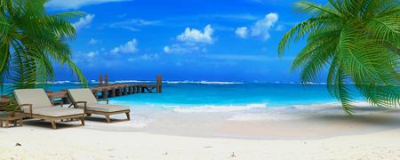 footbridge: 3D rendering of a pair of lounge chairs by a jetty on a tropical idyllic beach Stock Photo