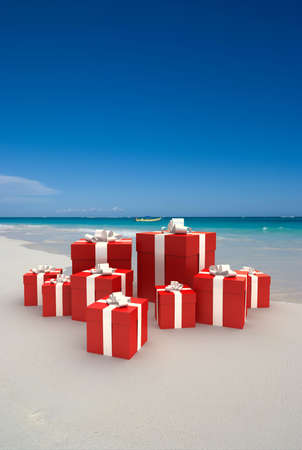 tropical christmas: 3D rendering of an arrangement of gift boxes on a tropical beach