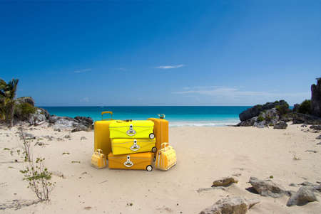 Pile of yellow luggage on a tropical beach Stock Photo - 4755560
