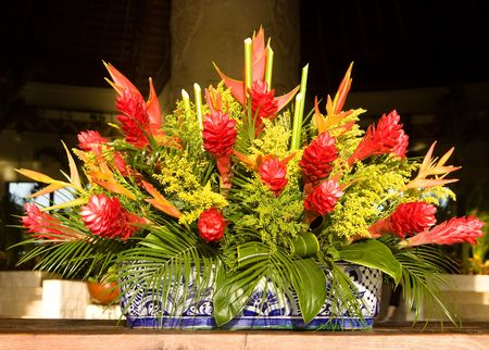 floral arrangement: Tropical flower arrangement on a ceramic pot