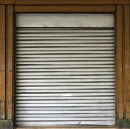 Old Shop frame with blinds down ideal for backgrounds photo
