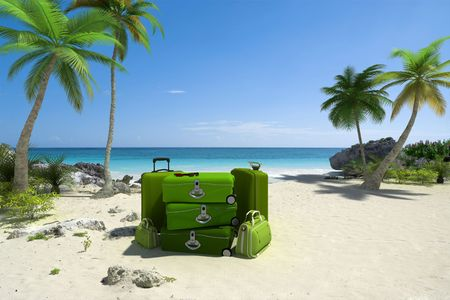 Pile of green luggage on a tropical beach photo