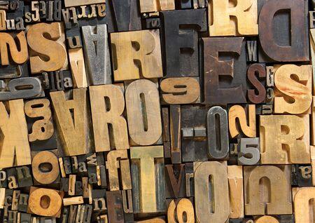 typescript: Background of vintage wooden print letter cases