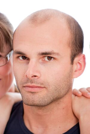 Young man portrait  with a woman at the background Stock Photo - 5474492