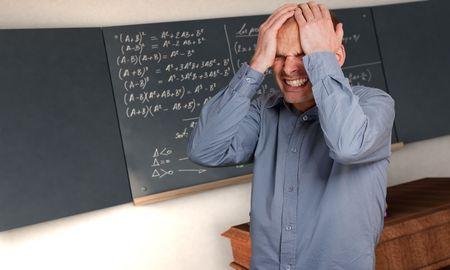 formulae: Desperate man in a class with complicated formulae in the blackboard