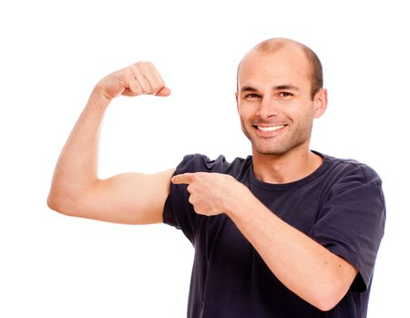 boasting: Young man boasting of his biceps
