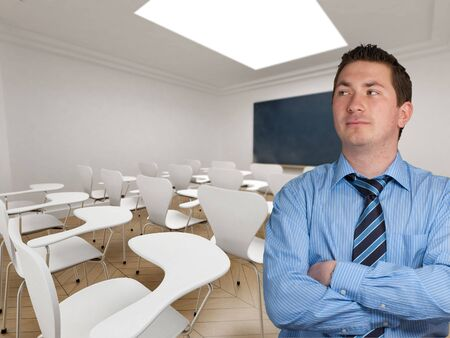 Young teacher smartly dressed in an empty classroom photo