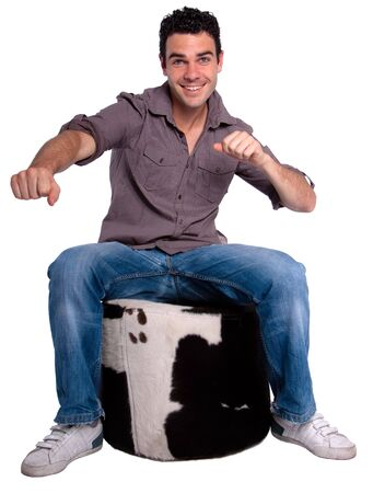 hassock: Seated portrait of a happy young man Stock Photo