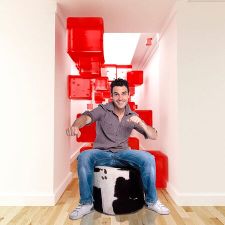 Happy young man in a surreal decor photo