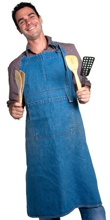 Man with an apron and cooking tools against a white background photo