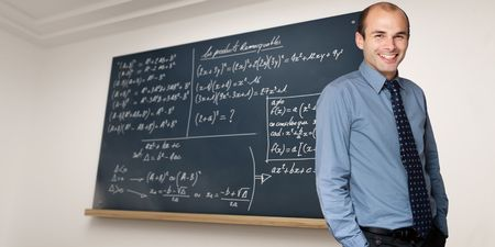 formulae: Teacher in a mathematics lesson with blackboard full of formulae