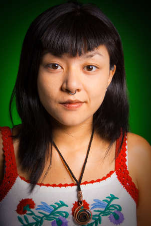 Portrait of a young Asiatic woman with a piercing Stock Photo - 5653227