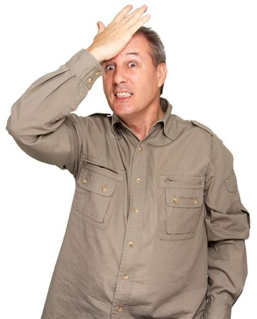 desperation: Portrait of a man tapping his forehead in desperation