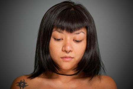 Portrait of a young Asiatic woman with a piercing Stock Photo - 5653225