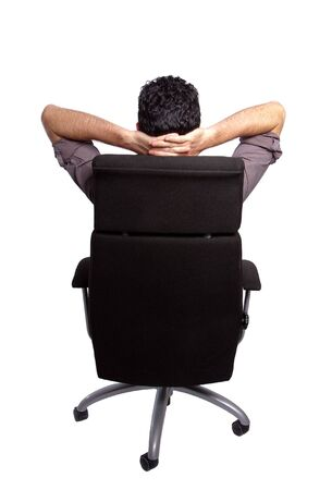 Back view of a man relaxing on an office chair photo