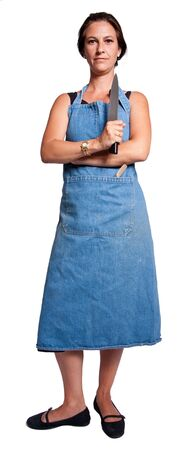 Woman with knife with an apron staring at the camera Stock Photo - 5701397