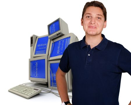Young man with a pile of computers in the background Stock Photo - 5701410