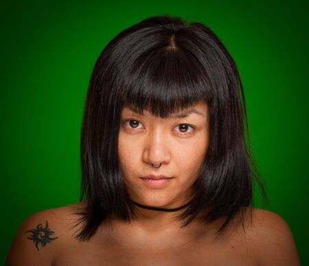 Portrait of a young Asiatic woman with a piercing Stock Photo - 5701429