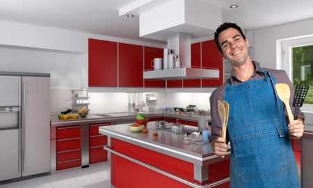 Young man with apron in a modern kitchen photo