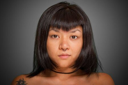 Portrait of a young Asiatic woman with a piercing Stock Photo - 5706197
