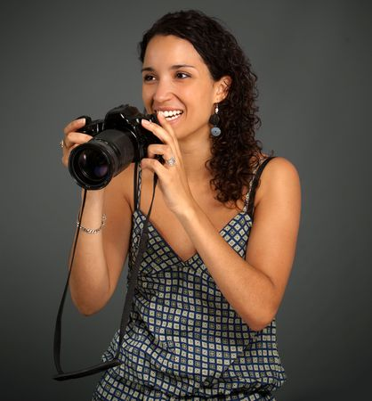 Smiling pretty girl taking pictures Stock Photo - 5717334
