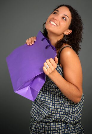 Young woman holding a shopping bag Stock Photo - 5717352