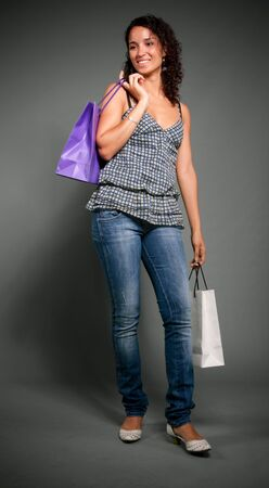 Young woman holding a pair of  shopping bags Stock Photo - 5717358