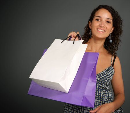 Young woman holding a pair of shopping bag Stock Photo - 5747198