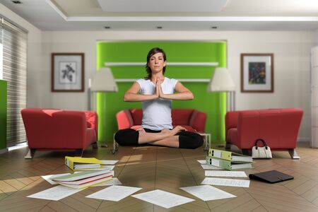 Woman levitation in the middle of a chaotic living room with documents spread on the floor. The images on the pictures on the wall are mine, so no copyright issue. Stock Photo - 5807503