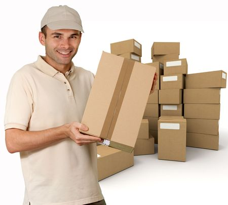 Isolated picture of a  cheerful messenger holding a cardboard box from a pile  photo