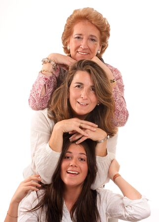 group of women:  Portrait of Three generations of women of the same family isolated in white