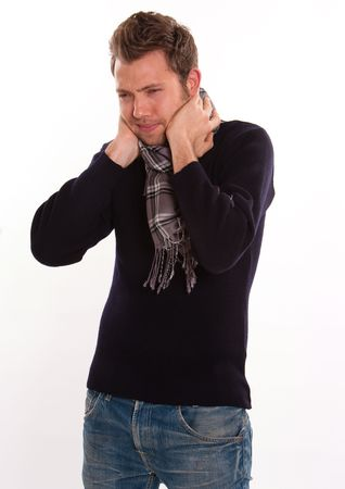 Young man holding his neck in a pain gesture  photo